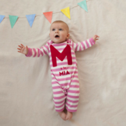 Gorgeous pink and white striped baby grow, personalised with your baby's name.