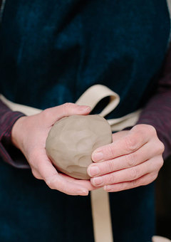 Pottery making techniques forming clay into a ball