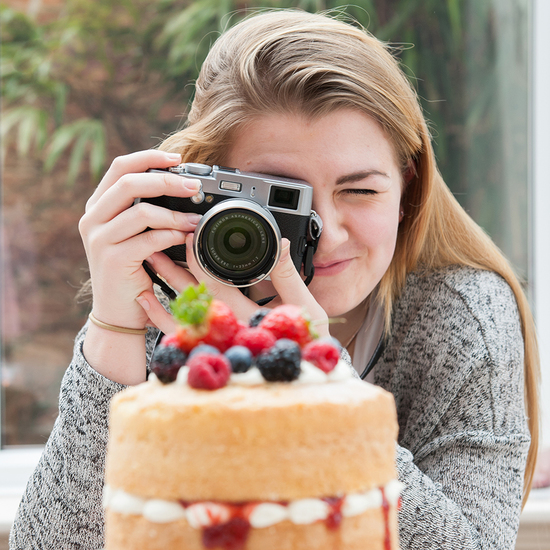 girl photographing cake