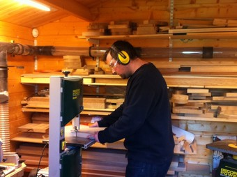 Joe in our first workshop, a 3m by 3m log cabin at the end of our garden.