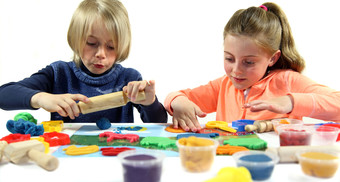Children playing with play dough