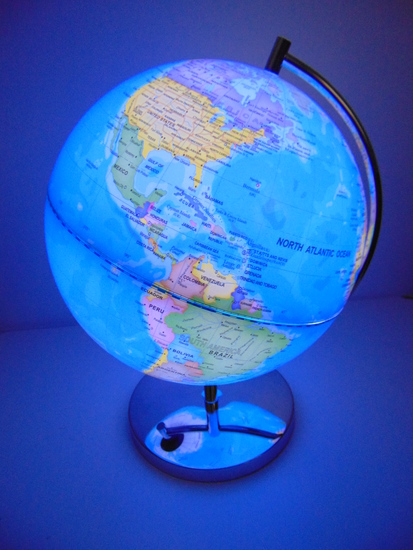 A beautiful light up globe of the world attractively presented on a shiny aluminium stand.
