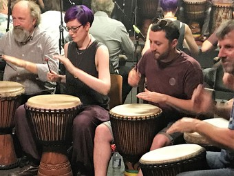 Learning to play djembe