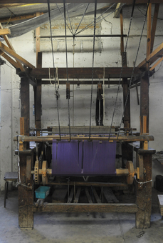 A wooden loom where our rebozo scarves are made
