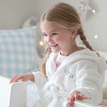 Our cozy fleece dressing gown is ideal for night time and bath time.