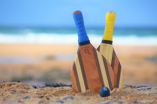 Beach bats and ball, beach games, beach racquet, beach paddle.