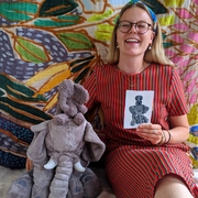 Illustrator, Gaby, with soft toys and their portraits