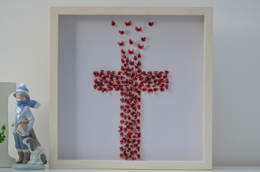 Remembrance is an iconic image of the cross formed from butterflies with a poppy design.