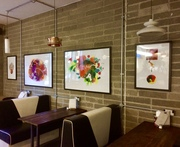 Prints hanging in a cafe