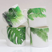 Tropical collection of Banana leaf, cheese plant, Palm and cabbage palm leaf design bone china mug by Rolfe and Wills