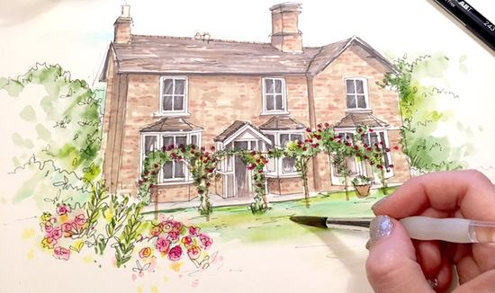 An action shot of a house being illustrated, showing the artists hand paintingfinishing touches to the scene