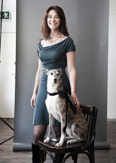 A woman and her Whippet/Blue Merle Collie cross