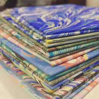 Bookbinding: pile of covers