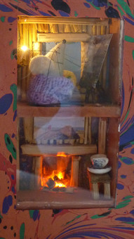 Miniature mouse house in a book,with a flickering fire and candle. This is the perfect nightlight