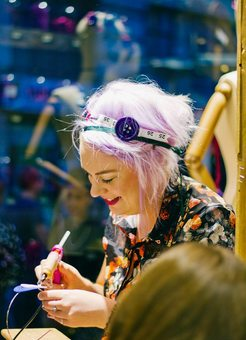 Sophie making custom headbands at London Fashion Week
