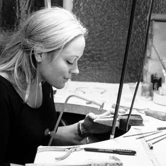 Jewellery designer Emma-Kate making jewellery at her workbench