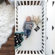 Baby boy in cot with triangle gift set