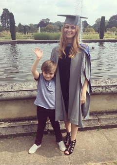 Sarah and her son on her graduation day
