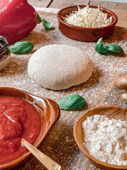 Make your own pizza kit recipe ingredients including dough ball, pizza tomato sauce cheese and basil