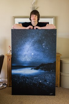 "Chad with a 54x36"" Canvas of 'Midnight Blue'"