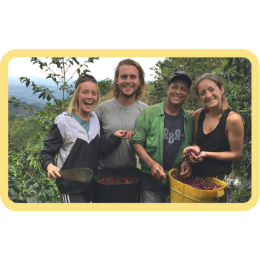 Laura and Tom in Colombia working on a coffee farm