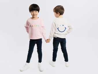 The Happy Sweatshirt features a big cute smile on the reverse and the word happy on the front in our signature rainbow text