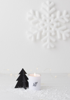 Christmas candle and snow