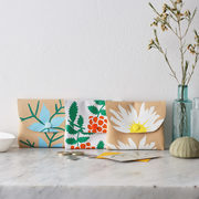 A popular selection of Botanical Leather Coin and Card Purses hand screen printed by Jenny Sibthorp