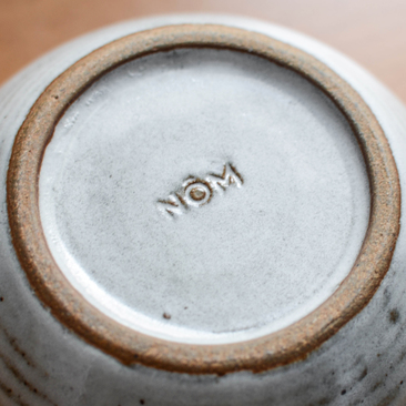 Nom Living Clay Stamp Logo