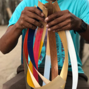 Artisan holding dyed natural straw leafs