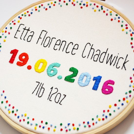 a personalised birth announcement embroidery in rainbow colours