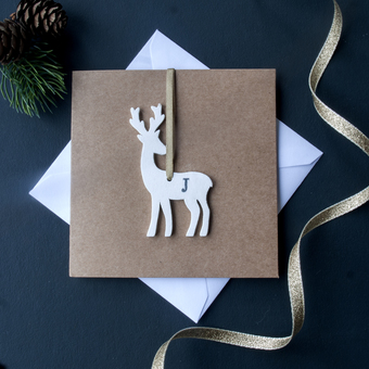 Brown Kraft Christmas Card with personalised white reindeer hanging decoration