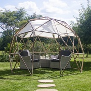The garden pod with table and chairs and shade sails
