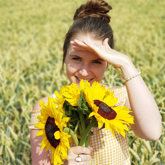 Sarah-jayne in a field with sunflowers