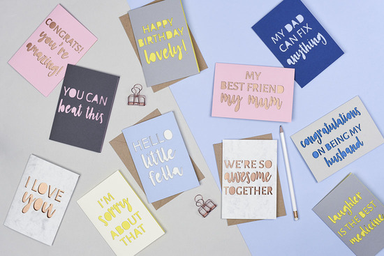 Laser cut typography greetings cards
