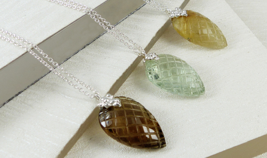 Semi precious stone carved leaf pendants