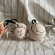 Hand painted ceramic baubles with sun and moon illustrations
