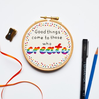 a rainbow themed hand embroidery of the quote 'Good things come to those who create'