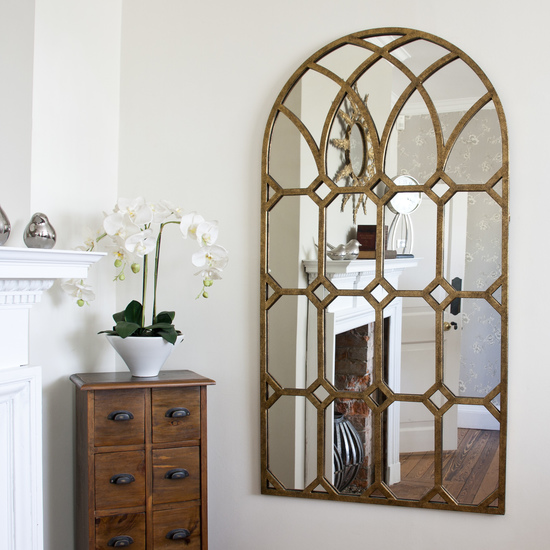 The stunning rustic gold metal window mirror