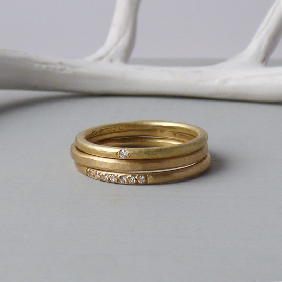 trio of fairtrade gold ethical wedding rings