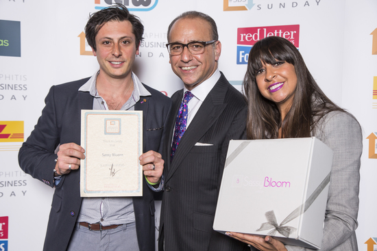The founders receiving their 21st award from ex Drgagon Theo Paphitis