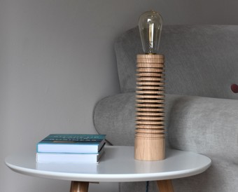 The Branscombe Lamp base is hand-turned from sustainable Ash wood sourced in Devon.