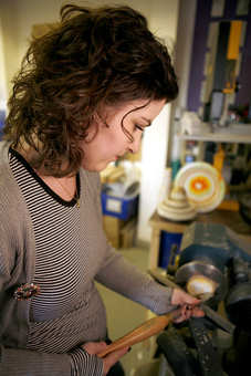 Working on the lathe, turning recycled paper. Hannah Lobley. Paperwork. Bespoke paper products.