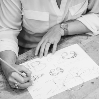 Emma-Kate hand sketching designs of bespoke jewellery