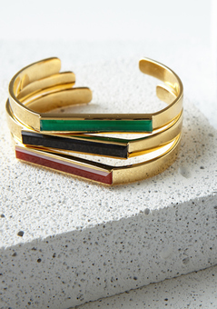 The geometric lines in this collection embrace deep jewel tones that reflect a bold attitude with subtle sophistication.