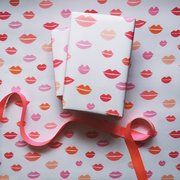 Wrapping pape in pink and red kiss repeat pattern
