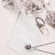 Chloe Lewis logo display and crystalline collection