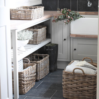 boot room with grey wicker rattan baskets