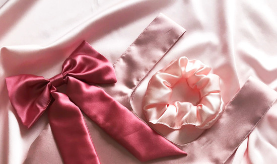 Header with logo in center and two modelled product shots of a scrunchie and eye mask