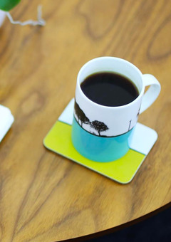 The Art Rooms landscape mug and landscape coaster by designer Jacky Al-Samarraie